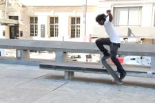 Mack Machine does skateboarding tricks outside Love Park in Philadelphia, PA