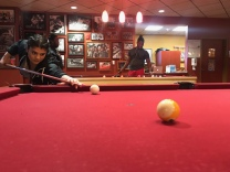 Brianna Vencheschy prepares for a pool shot at Profs Place in Rowan University's Student Center on April 9, 2018