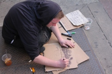 Stranded homeless man in Chinatown Philadelphia uses cardboard art creations to collect funds for a bus ticket on April 28, 2018