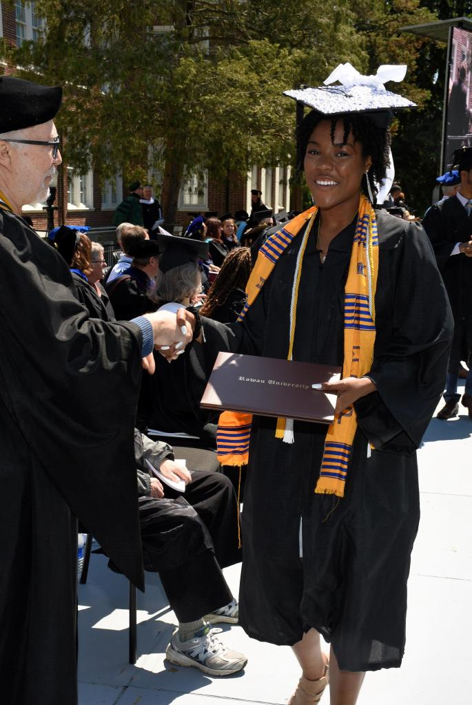 Briana M. Andrews collects diploma at Rowan University College of Communication and Creative Arts CCCA commencement on May 15, 2019