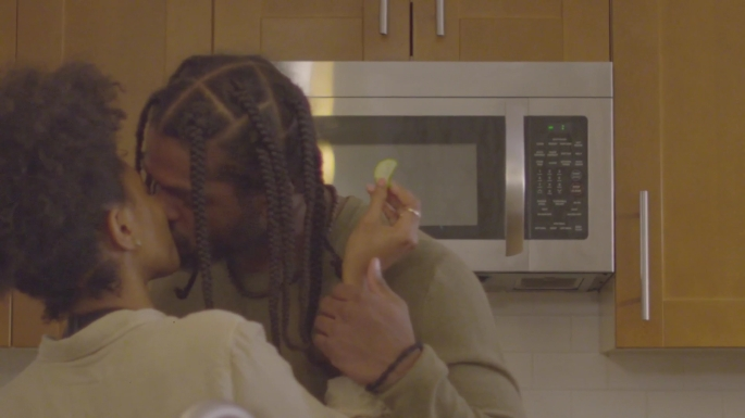 Romantic kiss, catered meal date no-show scene from Let Live Film. Actors Enoch Jones and Cashaey Serenity, pictured. Kiss, black, african-american, couples, braids, natural hair, independent film, kitchen.